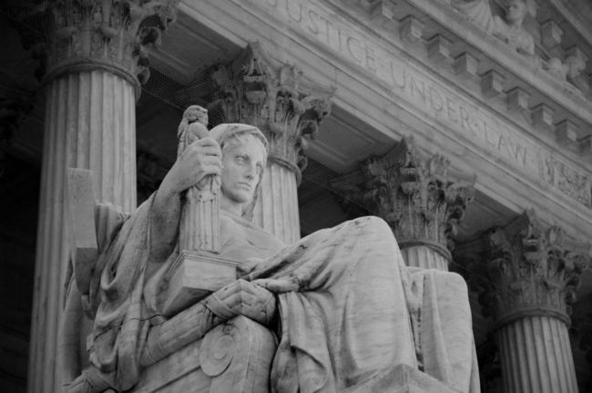 Statue overlooking the steps of The Supreme Court