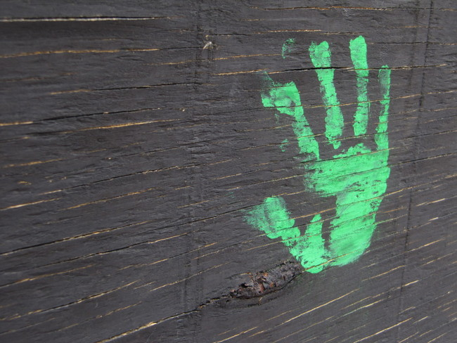 A lone hand imprint decorates the wall opposite the park in Reston Town Center.