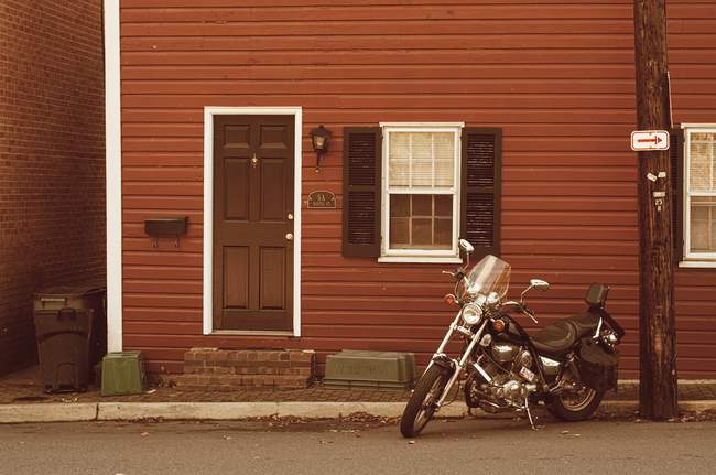 A motorcycle sits outside a small residence in Leesburg