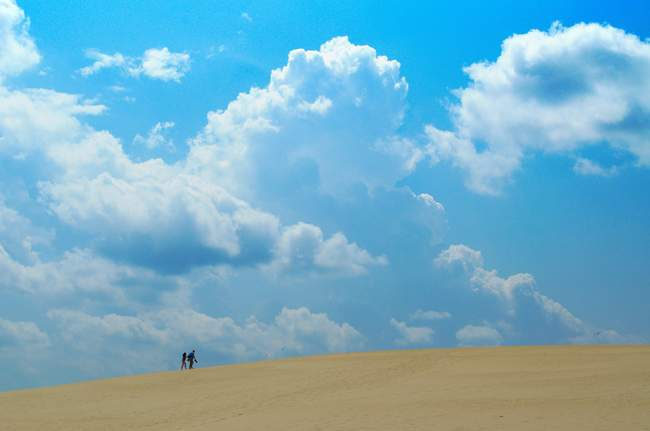 A couple walking on Jockey's Ridge